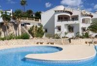 Beautiful corner house, south-east facing, in Los Alcazares with view of the communal pool and beautiful open view to El Portet and the sea